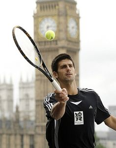 Serbian tennis player Novak Djokovic is pictured during a photocall with London Mayor Boris Johnson (not pictured) to encourage sports participation within local communities, outside County Hall, in London on June 18, 2008. AFP PHOTO/Shaun Curry (Photo credit should read SHAUN CURRY/AFP/Getty Images)