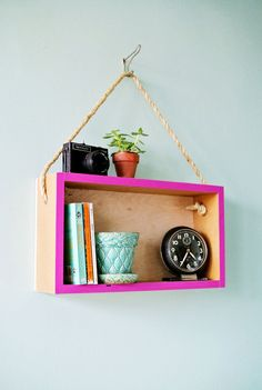 This cheap DIY hanging shelf is an easy way to make your home look more sophisticated