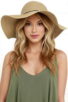 """Take refuge under the cute and floppy brim of the Sunny Street Tan Floppy Straw Hat! Tan straw hat is accented by a brown, waxed cord (tied in a bow) above the 4.5"""" brim."""
