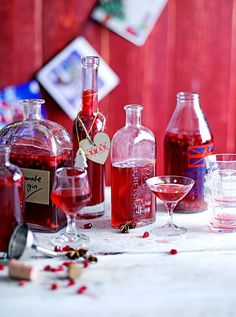 Spiced Pomegranate Gin | Jamie Oliver. Heat 350 g caster sugar 200 ml pomegranate juice 12 whole peppercorns 4 cinnamon sticks 4 star anise zest and juice of 1 clementine to a gentle boil, then cool.  Add seeds from 3 pomegranates and 1 litre Bombay Sapphire gin.  Leave for 2 weeks or up to 2 months in cool dark place.