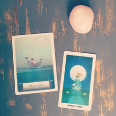 """Social Media is reminding me that it is Internatonal Women's day. Inspired by @mnomquah 's post I decided to get out my most feminine deck of cards and ask how I best connect with the divine feminine aspect in me. Just look at those cards - made me a little emotional actually.To the Sea: """"...going with the flow is exactly what you need to do right now. Allow trust and faith to guide you forward as you flow like a river into the sea of life""""  Queen of cups: """"Queen of love emotional integrity…"""