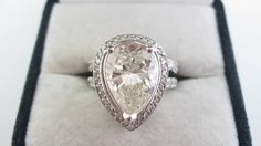 This consignment ring features a 4.63 carat pear shaped, center diamond.