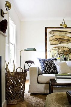Neutral rustic living room with brass accents, baskets, and white sofa.
