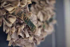 I totally need to make one of these with my husband's old uniforms! directions on how to make a ripped fabric wreath  http://www.inspiringcreationsblog.com/2009/11/rag-wreath-tutorial.html