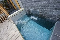 Wellness City Garden with Modern Rustic Design: Small Swimming Pool Stony Wall Blue Water Wooden Floor ~ dickoatts.com Amazing Home Designs Inspiration