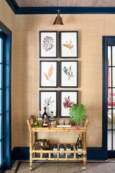 The Glam Pad: Kemble Interiors Revives a Palm Beach Retreat / sea grass wallpaper with navy trim, botanical prints, and bamboo bar cart Interior Trim, Interior Design, Interior Shop, Trim Paint Color, Paint Colors, Painting Trim, House Painting, Bars For Home, Palm Beach