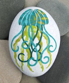 Hand Painted Cape Cod Beach Stone: This whimsical teal jellyfish makes a unique paperweight for your desk or a pretty decorative item. on Etsy, $35.00