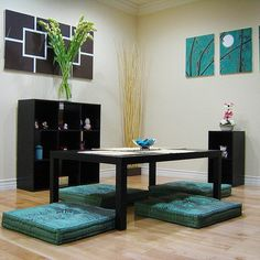 Japanese dining room designs for small space with low table and pillow