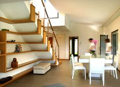 Briliant idea for storage originating from the staircase ... MAS Arquitectura designed a galician traditional house on light forms located in A Coruña, Spain