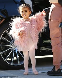 Kim's sister Kourtney took the two-year-old to her ballet class on Wednesday where the tot showed off a luxurious pink fur jacket