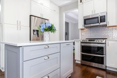 Stacked whites shaker cabinetry with a grey shaker island.. PERFECTION !