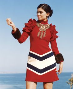 Baroque Mod - Kylie Jenner wears the sort of Gucci dress that might have been dreamed up specifically for social-media royalty: Note not just the attention-grabbing ruffle-puff shoulders but the graphic chevrons, the trendy long sleeves, the soft mink cuffs, and the selfie-friendly gold-embroidered neckline; select Gucci boutiques. Cartier bracelet.