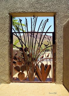 Mountain Gateway    Looking through a decorative gate to Bren Mountain, one of the lower peaks in the Tucson Mountain range, near Tucson Arizona. Elevation 3988 ft.
