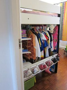 """Lil more along line of how a closet space built into the foot of loft bed would look. She used a pre-existing loft bed so got extra stuff there. Top is a towel rack o.o ikea has a """"BYGEL rail that cost 3 for the 21 3/4 model and 4 for the 39 1/4 model. (perhaps if go with the smaller one can also put shelves to left and not use whole space. Wonder about strength of the beam used to support both bed and rod... I would ditch the bins and cover with a curtain or something....)"""