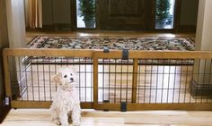 This attractive freestanding pet gate expands to 70 inches and can be placed anywhere without damaging walls or trim