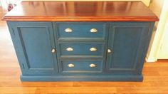Navy sideboard with gold handles. Facebook.com/bevelled.edge