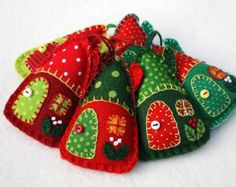 Green and white felt Christmas ornaments.  Set of three little hanging houses, handmade with felt and vintage cottons in green and white. The roofs, doors and windows are hand- appliqued with vintage cotton fabrics, embroidered berries grow on the walls, and the door knobs are tiny buttons.  Handmade in Ireland.  Approx 8cm / 3 inches high. The listing is for 3 houses.