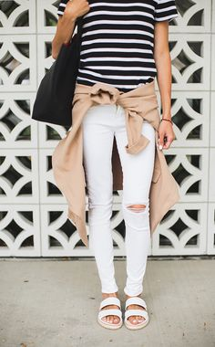 White distressed jeans, striped shirt, and camel colored cardigan