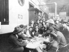 A photo of men playing cards at a saloon in Bisbee, Arizona during 1908.  This image is from the photograph collection of the Bisbee Mining & Historical Museum.  Discover more Bisbee, Arizona images and artifacts