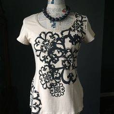 """WHBM t-shirt Beautiful khaki colored t-shirt with black print and faux diamond accents in the flowers. Excellent condition, no sign of wear! Bust 17"""" length 24"""" White House Black Market Tops Tees - Short Sleeve"""