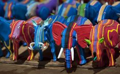 April 29, 2013, finished toy animals made from pieces of discarded flip-flops are laid out in rows to dry in the sun, having just been washed, at the Ocean Sole flip-flop recycling company in Nairobi, Kenya. The company is cleaning the East African country's beaches of used, washed-up flip-flops and the dirty pieces of rubber that were once cruising the Indian Ocean's currents are now being turned into colorful handmade giraffes, elephants and other toy animals. (AP Photo/Ben Curtis)