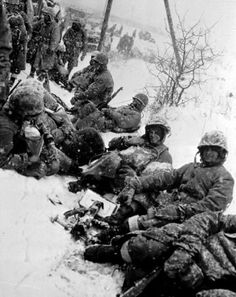 In this photo released by the US Marines, a group of Marines fighting their way from the communist encirclement at Chosin towards Hungnam, Korea, take a rest in the snow somewhere on the route in December of Marine Corps/AP Les Nations Unies, The Rok, Korean Peninsula, War Image, Us Marine Corps, Us Marines, Korean War, Vietnam War, Usmc