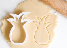 Pineapple Cookie Cutter- Use this cutter for a tropical themed party. All cookie cutters are white. This cookie cutter is 4in by 2.75in. These measurements are at the biggest point of the cutter. This is not dishwasher safe as the high temperatures may damage the plastic.