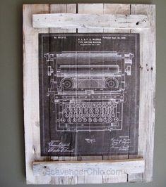 Pallet wall art made from replica vintage patent posters.