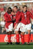 Football European Championships 2000 Qualifier Wembley 27th March England 3 v Poland 1 England's Paul Scholes is congratulated by teammates LR Andy...