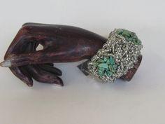 DBANE SEED  02 turquoise and glass seed beads sewn onto crocheted raffia base ZAR 495