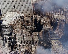 Ground Zero, New York City, N.Y. (Sept. 17, 2001) -- An aerial view shows only a small portion of the crime scene where the World Trade Center collapsed following the Sept. 11 terrorist attack. Surrounding buildings were heavily damaged by the debris and massive force of the falling twin towers. Clean-up efforts are expected to continue for months. U.S. Navy photo by Chief Photographer's Mate Eric J. Tilford