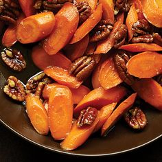 Honey glazed carrots with pecans. You can pretty much make glazed carrots with anything - cinnamon, maple syrup, balsamic, ginger, or even just terragon or parsley. Thanksgiving Salad, Thanksgiving Side Dishes, Thanksgiving Recipes, Fall Recipes, Holiday Recipes, Thanksgiving Vegetables, Pecan Recipes, Wine Recipes, Cooking Recipes