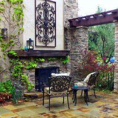 mediterranean patio by Lisa Hallett Taylor -- love the wrought iron!