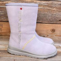 I ❤️ UGG Kisses Short Moonstone Sheepskin Boots 10 No trades! New! The classic beach boot in super cute, sweetheart style!    This style is SOLD OUT in stores! Model #1005859 Soft suede upper with contrast stitching. Fully UGGpure sheepskin lined. Hidden stash pocket inside shaft.  UGG does not recommend walking on icy surfaces.  Heel Height: 1 3/4 in Insole length: 10 1/2 in 100% Authentic UGGs with original packing.  Measurements are of actual item listed. UGG Shoes Winter & Rain Boots