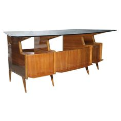 A Rare Gio Ponti Executive Desk | From a unique collection of antique and modern desks at https://www.1stdibs.com/furniture/storage-case-pieces/desks/