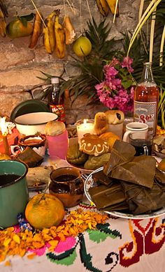 Closeup, Veracruz, Mexico home ofrenda with banana leaf tamales & hanging pan de muerto in shapes of little spirits. Ofrenda de Día de Muertos.1 y 2 de noviembre.
