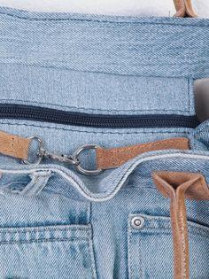 Bolso en tejido vaquero forrado con asas en símil piel