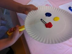 Magnet Painting!  Manoeuvring the Magnet under plate, moving the paper clip around to paint!