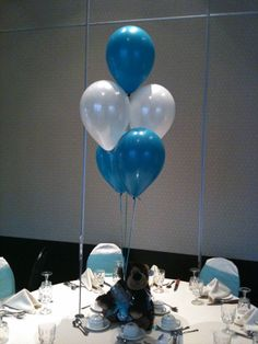 Teddy bear centerpieces with helium balloon table bouquet.