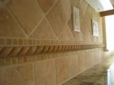 images kitchen dark cabinets travertine backsplash glass border - Google Search
