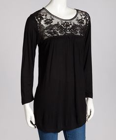 This trendy top adds pretty panache to any ensemble. A lace design meets a comfy three-quarter sleeve silhouette so that every look is fashionably phenomenal.Measurements (size M): 29'' long from high point of shoulder to hem100% viscoseHand wash; dry flatImported