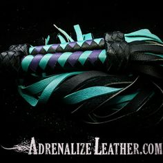 Turquoise, purple, and black flogger set. www.etsy.com/shop/adrenalizeleather #kink #leather #fetish #bondage #bdsm #gear #toys #sale #leathermen #leatherwomen #leatherwork #flogger #whip
