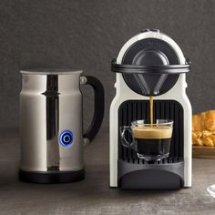 The Nespresso Inissia Espresso Maker features a tiny footprint and compact design, perfect to kitchens where counterspace is at a premium. With simple to use, one touch operations that delivers 19 bar pressure and 25-second fast heat technology, coffee lovers will be impressed with the Inissia's barista-quality coffee and rich, full crema. Includes Aeroccino Milk Frother.
