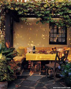 Cozy, romantic dining spot under grape-covered arbor