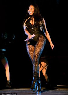 Risqué: Nicki Minaj delivered a sexy wallop on stage while dressed in a black corset and lace stockings at the sold-out Tidal X: 1020 concert at Brooklyn's Barclays Center, New York on Tuesday