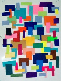 """Students chose a shape to use, cut a variety of colors and sizes of the shape from construction paper. They arranged them on 81/2 x 11"""" stiff paper then glued them in place. Emphasis on shape and color arrangement."""