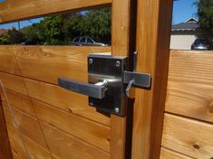Alta Stainless Steel Gate Latch for Double Gates. Western Red Cedar stained with Benjamin Moore Arbor Coat in Teak. Alta Contemporary Modern Stainless Steel Gate Latch (with Dummy Handle as it's a double gate) Sliding Fence Gate, Chain Link Fence Gate, Wooden Fence Gate, Fence Doors, Sliding Patio Doors, Wood Fences, Fencing, Fence Gates, Privacy Fences