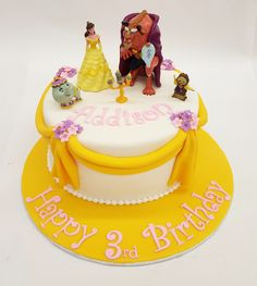 A Beauty and the Beast cake with draped fondant and little flowers, pretty enough for Belle!