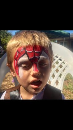 Spider Man inspired face paint by me  (funnybunnyentertainment/ms scarlett makeup and hair)