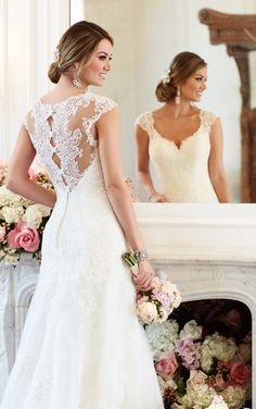Romantic A-line wedding gown from Stella York boasts eye-catching lace cap sleeves and a scalloped-lace illusion back.